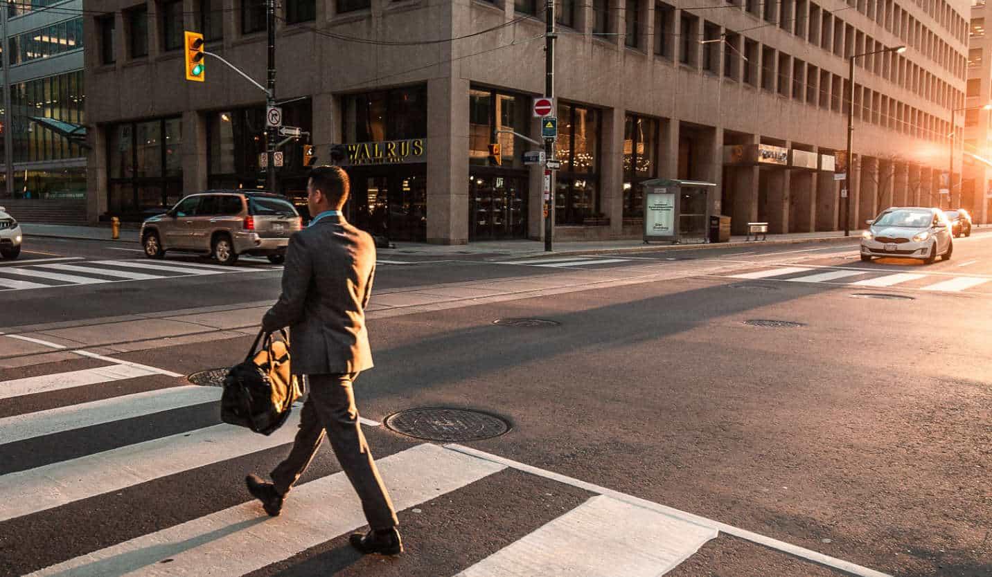 Businessman crossing a street